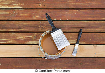 Paint Brush on top of open can of stain - Horizontal photo...
