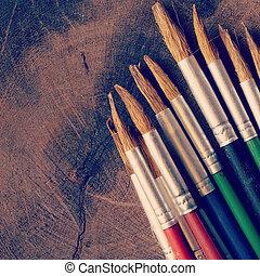 paint brush on wood background old retro vintage style