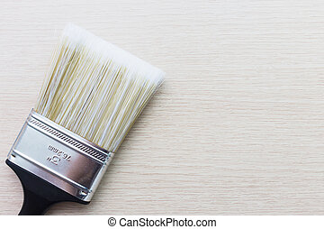 paint brush on wood background with space for text
