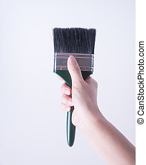 paint brush or paint brush in a hand on background.