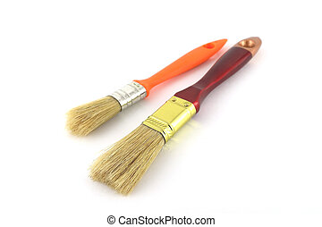 Paint brush with brown and orange handles
