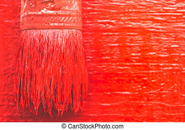 Paint brush with red paint. To paint the board of girls. Painting works.
