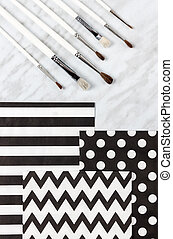 Paint brushes and decorative paper for arts and crafts
