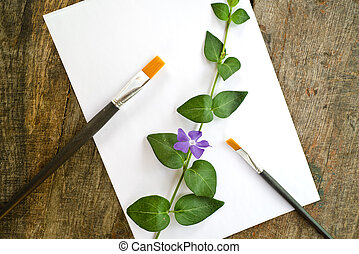 Paint brushes, flower and white paper - Paint brushes,...