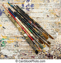 paint brushes on paint background