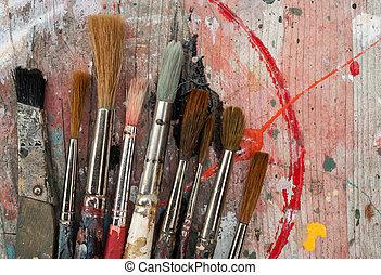 paint brushes on wood background