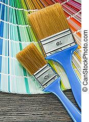 Paint brushes pantone fan on wooden board