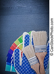 Paint brushes pantone fan protective gloves on wooden board