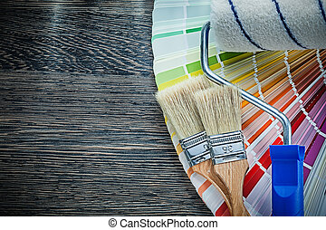 Paint brushes roller color pantone fan on wooden board