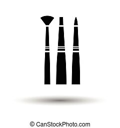 Paint brushes set icon. White background with shadow design....