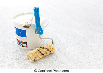 Paint bucket with roller brush on white.