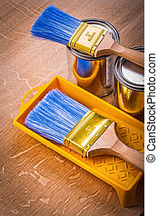 paint can brushes tray on wooden board construction concept