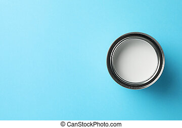 Paint can on blue background, top view