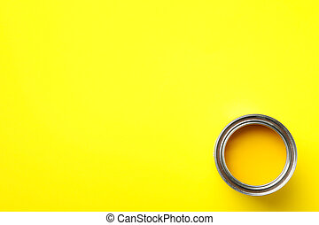 Paint can on yellow background, top view