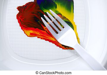 Paint colorful mix with a plastic fork