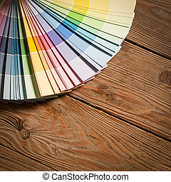Paint colour palette on a wooden surface.