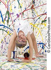 Paint Girl - Ten year old girl doing back bend towards...