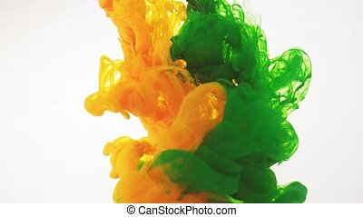 Paint moving in water, white background. Green, yellow...