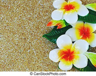 paint of plumeria flower carved on brick background with space background