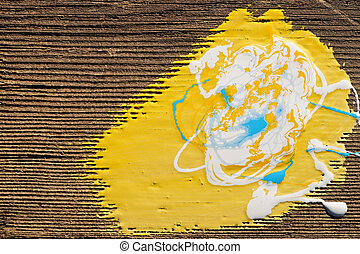 Paint on old wooden background