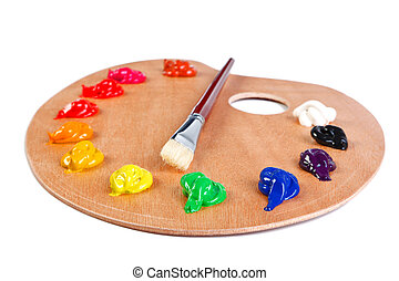 Photo of a wooden artists palette loaded with various colour paints and brush, isolated on a white background with clipping path.
