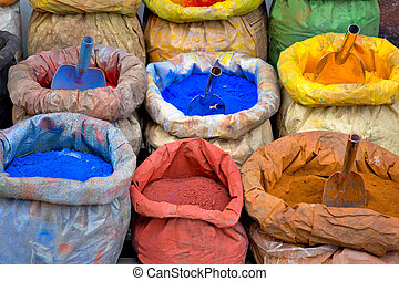 sacks with paint pigment in different colors for sale