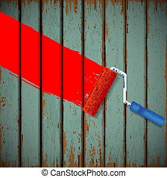 paint roller and an old wooden fence