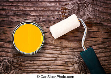 Paint roller and color tin can on wooden background - Small...