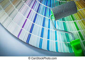 Paint roller color palette on white background