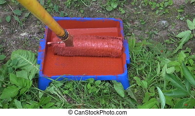 paint roller in paint can