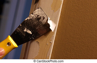 Paint Scrapping - A close-up of a person stripping paint ...