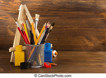 paint supplies on wooden background