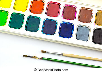 Paint tray and brush on white background