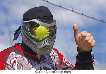 Paintball Head shot - Paintball sport player with head shot...