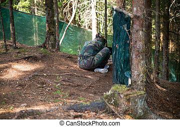 Paintball player Hiding