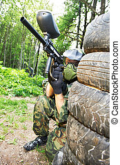 paintball player holding position - paintball sport player...