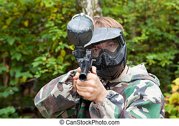 paintball player is aiming, looking in the face