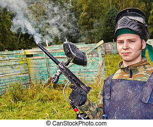 Paintball player shoots out the gun