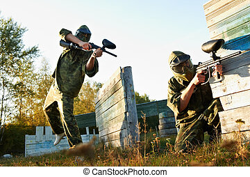 paintball player under attack - paintball sport players...
