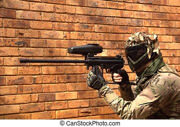 Paintball player with a gun