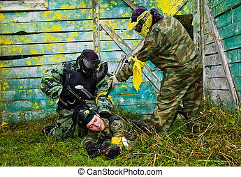 Paintball players captured the enemy
