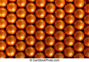 Paintballs background - close up on orange paintball
