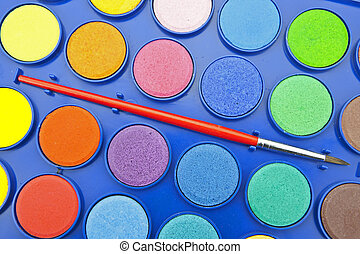 Water colors in a paint box with brush