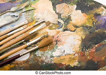 Paintbrush and Palette - Paintbrushes laying on an old used...