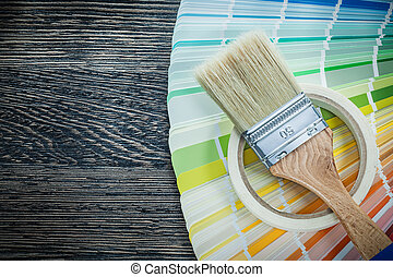Paintbrush color pantone fan adhesive tape on wooden board