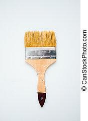 Paintbrush on the white background. Whitewashing brush