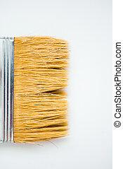 Paintbrush on the white background with copy space. Whitewashing brush, close up.