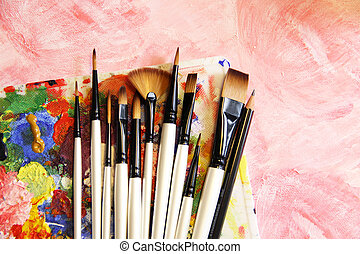 Paintbrushes and art palette