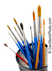 Paintbrushes holder - Paintbrushes in a metal mesh holder on...