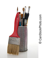 Paintbrushes in a metal mesh holder